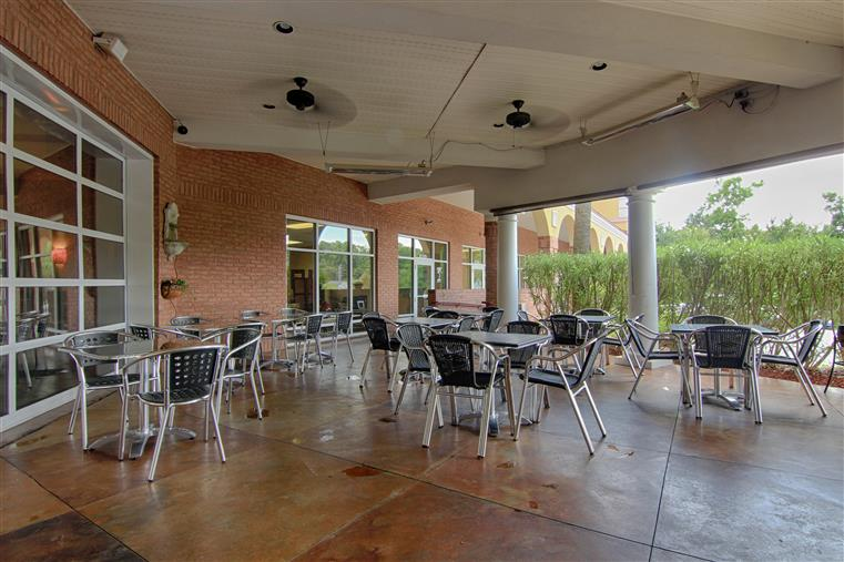 View of outdoor seating. Steel tables and chairs
