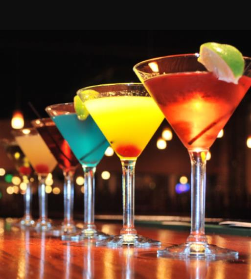 a row of martini glasses on the bar