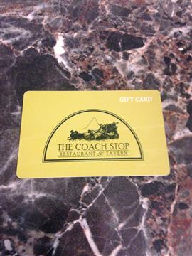 The Coach Stop Restaurant & Tavern gift card against a marble background