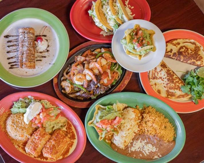 plates of food: chimichanga, enchiladas, fajitas