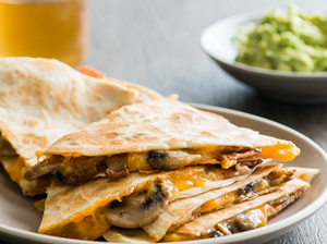 multiple quesadillas stuffed with chickens, mushrooms, and cheese