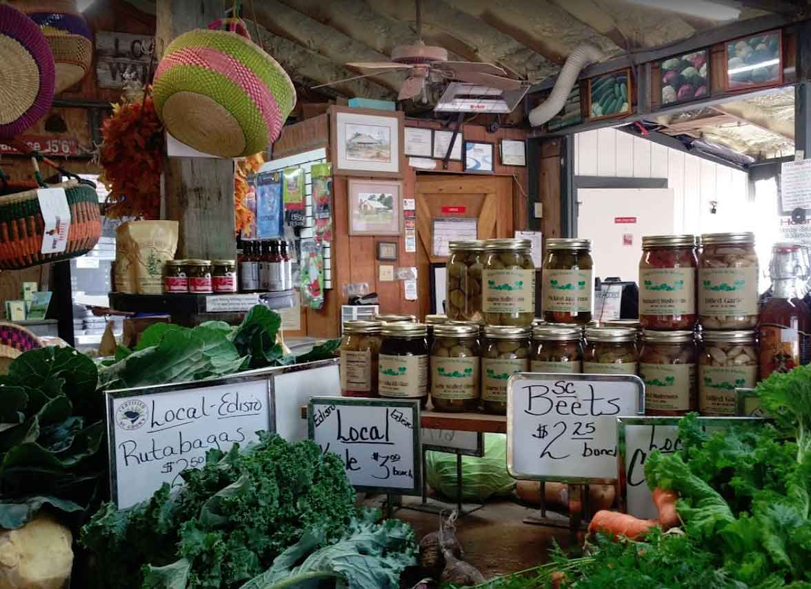 Fresh produce and jarred items on display for sale in market