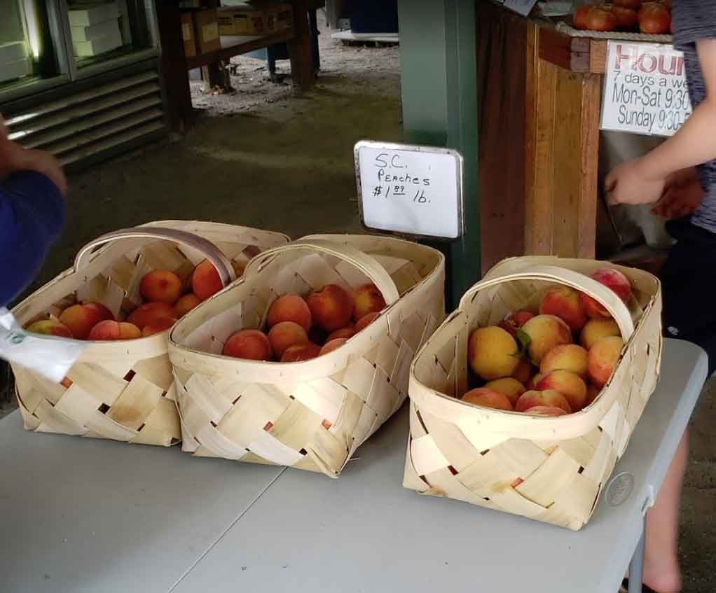 Peaches in baskets for sale