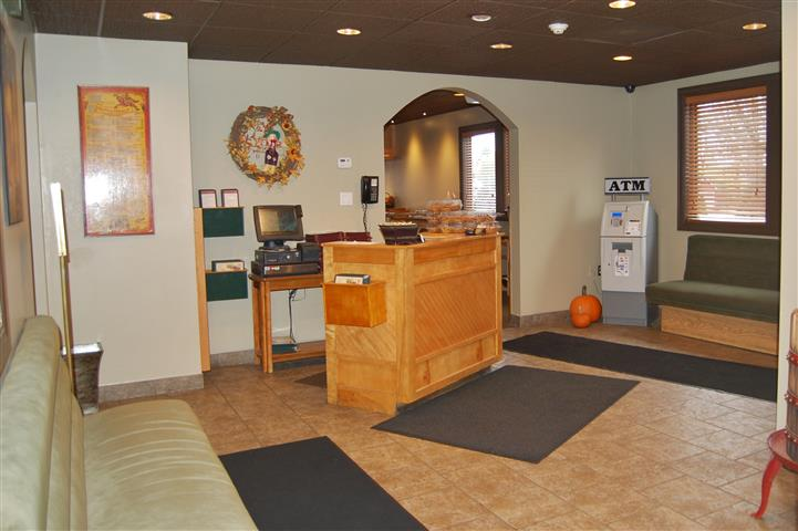 the host station inside the restaurant with an ATM in view