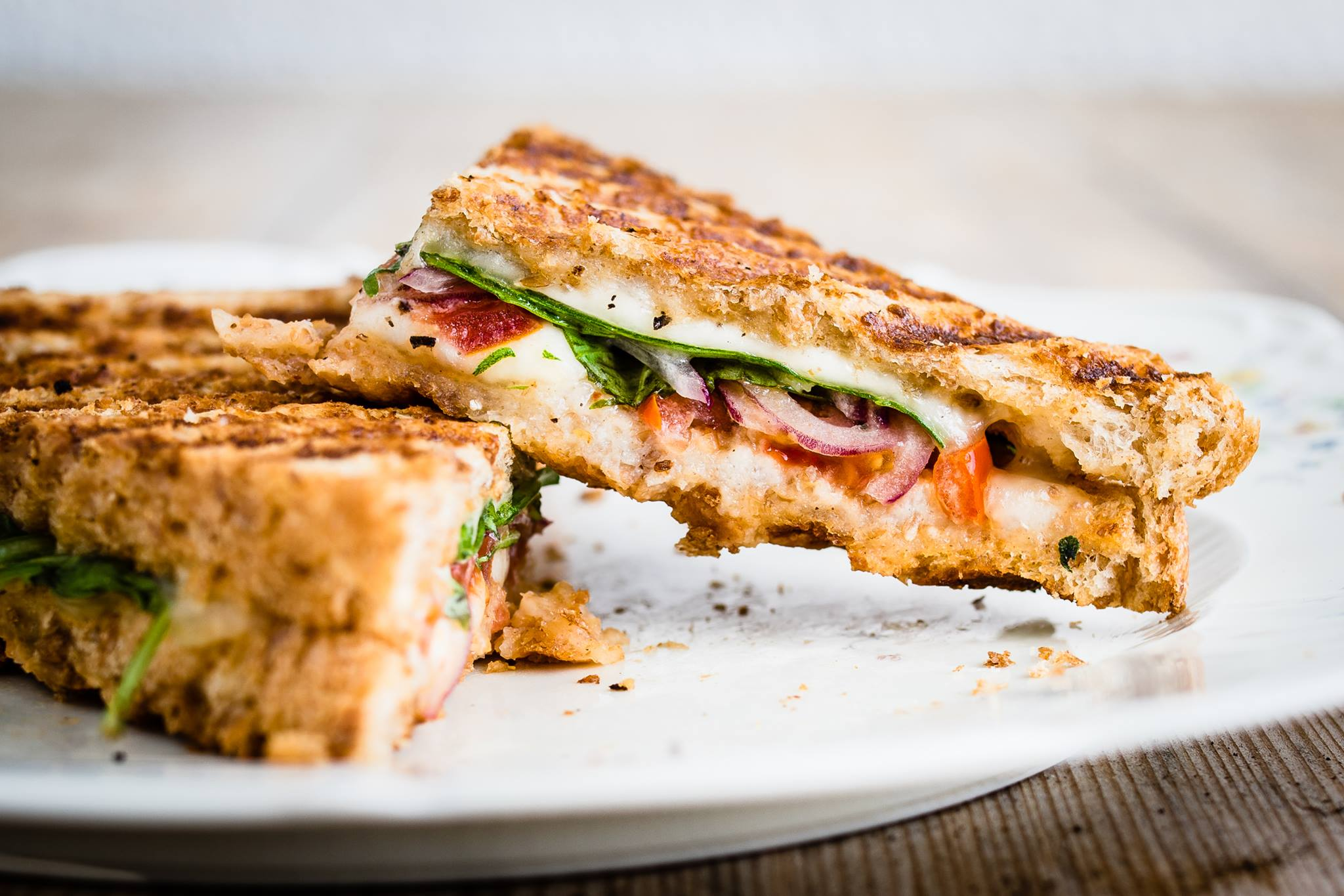 panini with spinach, tomato, onion and cheese
