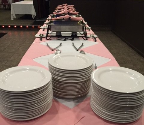 plates stacked up by the food catered by Tassone's wine garden