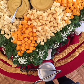 assorted cheese and crackers and dip for catering
