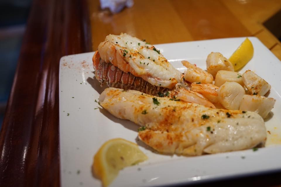 lobster tail with a side of shrimp and fish