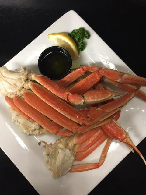 crab legs on a plate with a side of melted butter