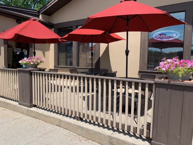 outdoor patio area with seats, tables, and umbrellas