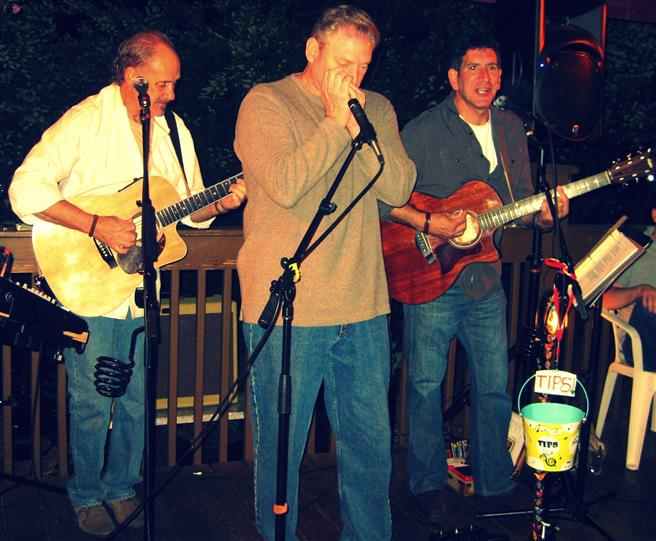 three men playing Live music outdoors