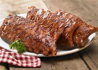 Baby back BBQ ribs on a plate