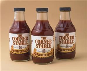 Bottles of The Corner Stable BBQ Sauce