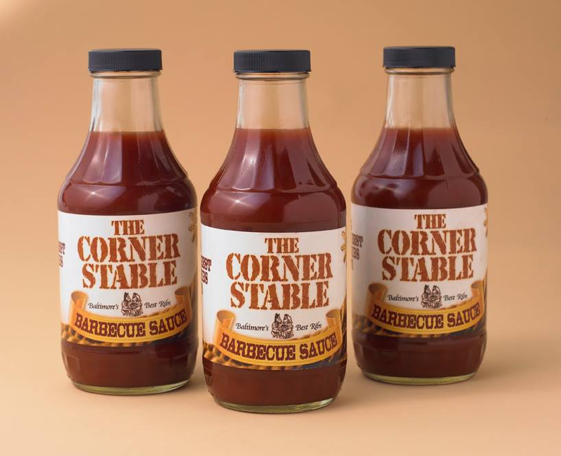 Three bottles of The Corner Stable branded bottles of BBQ sauce