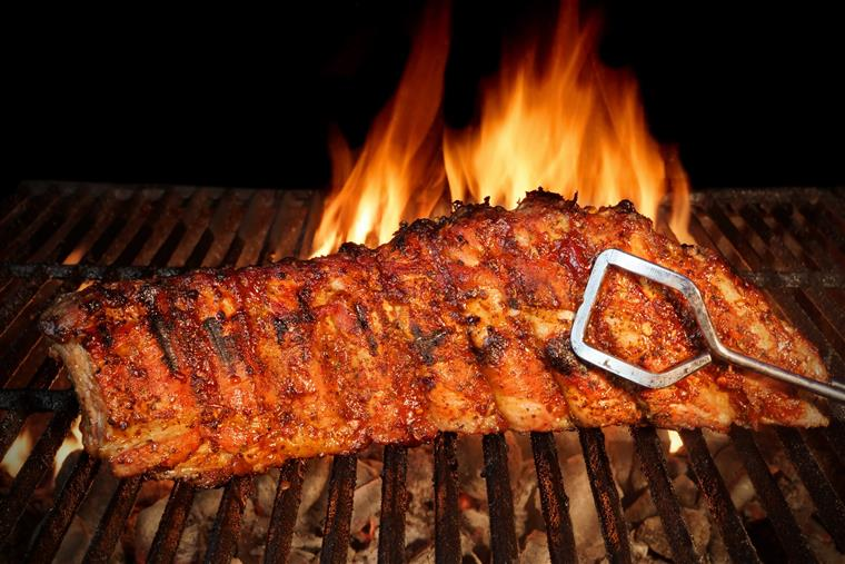 Rack of Ribs Cooking on Grill with flames