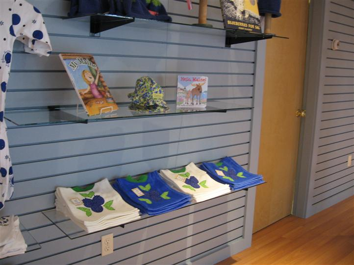 display with shirts and books