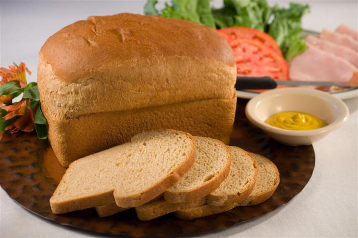 Loaf of bread with bread slices