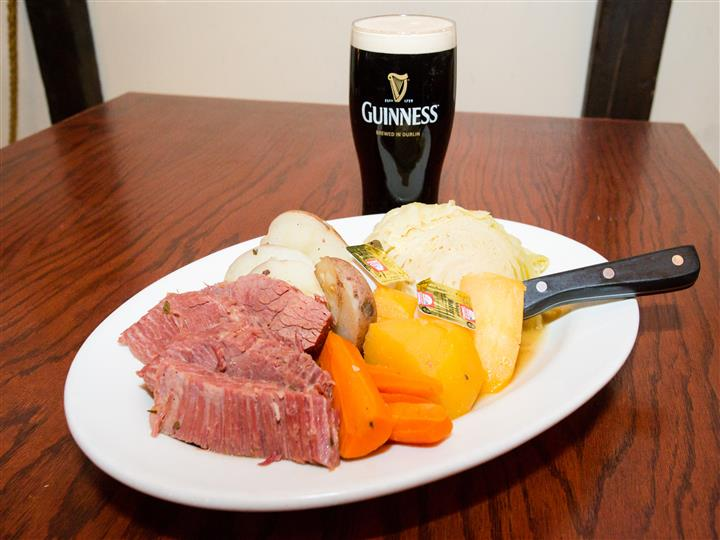 roast beef with carrots and potatoes with a glass of beer