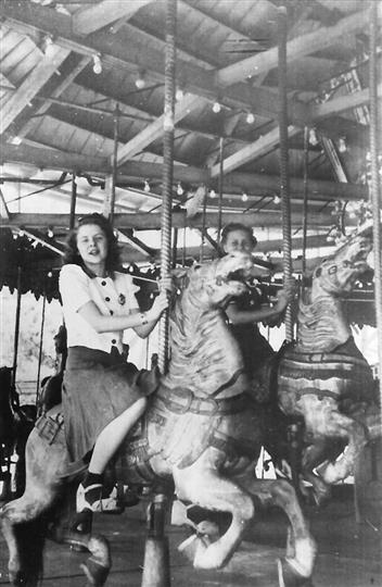 Vintage photo of a carousel with two girls on it