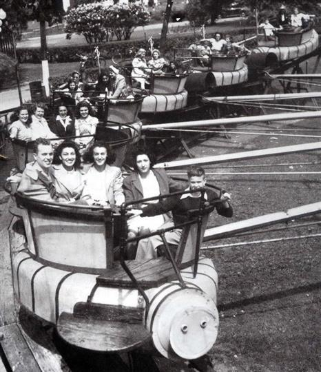 Vintage Photo of an old amusment park ride with people enjoying it