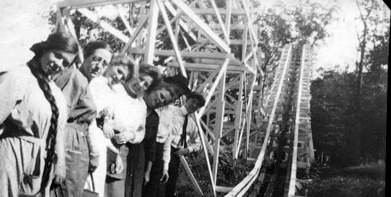 Vintage photo of people on a old roller coaster
