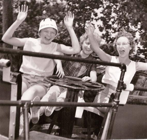 Vintage photo of people on a amusment park ride