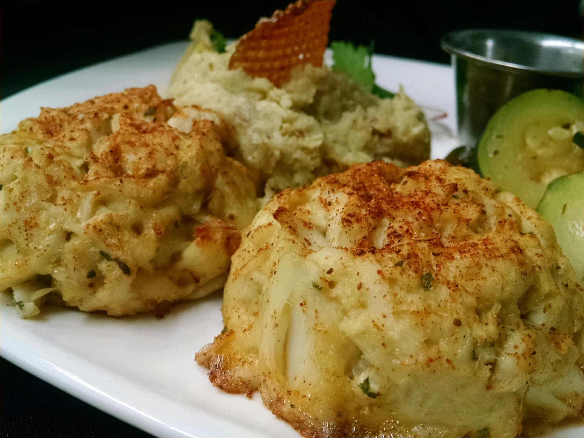 Jumbo and lump crabmeat in a classic mild sauce, seasoned lightly and broiled, served with homemade tartar sauce.