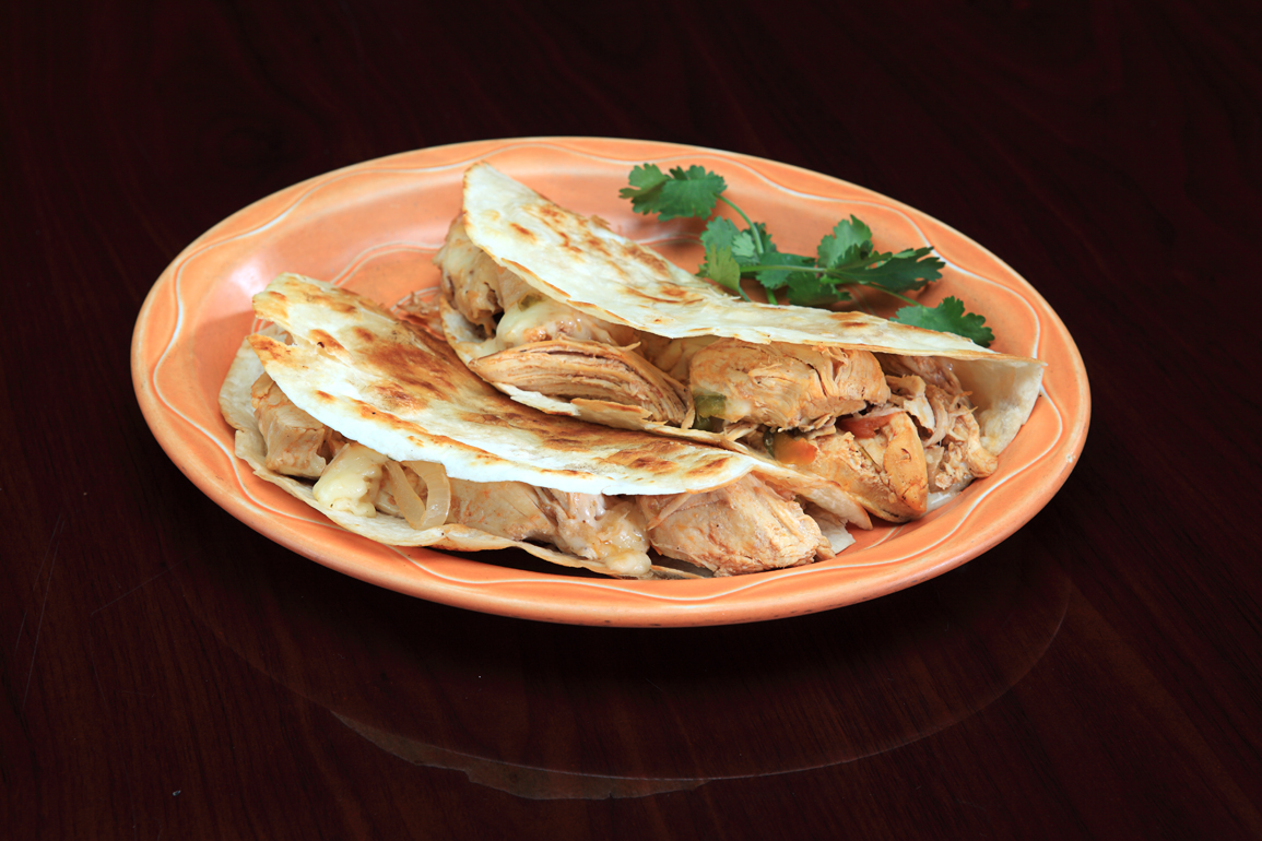 Two Chicken Tacos on orange plate