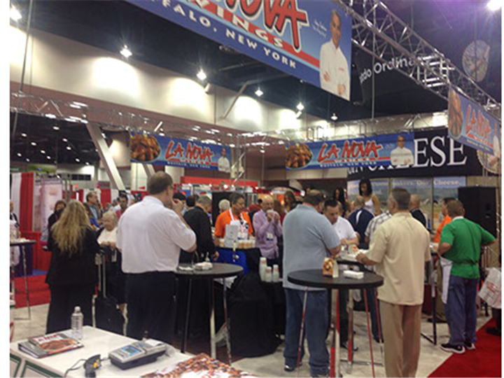 Crowd of people gather and eat at La Nova Wings station of food show.