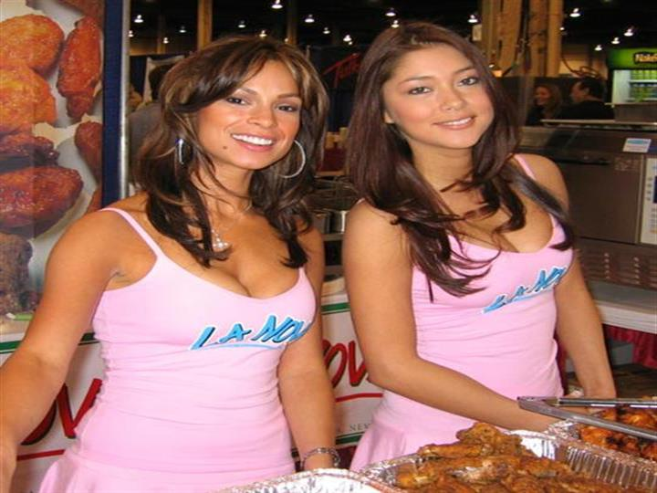 La Nova models handing out chicken wings at food show