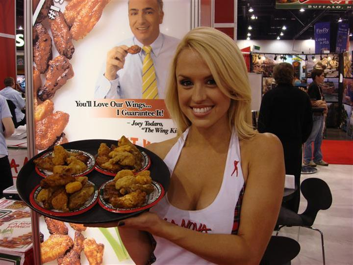 La Nova model holding tray of chicken wings