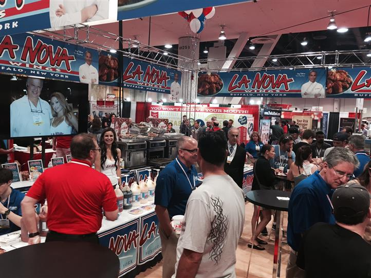 La Nova rep and crowd of people at food show