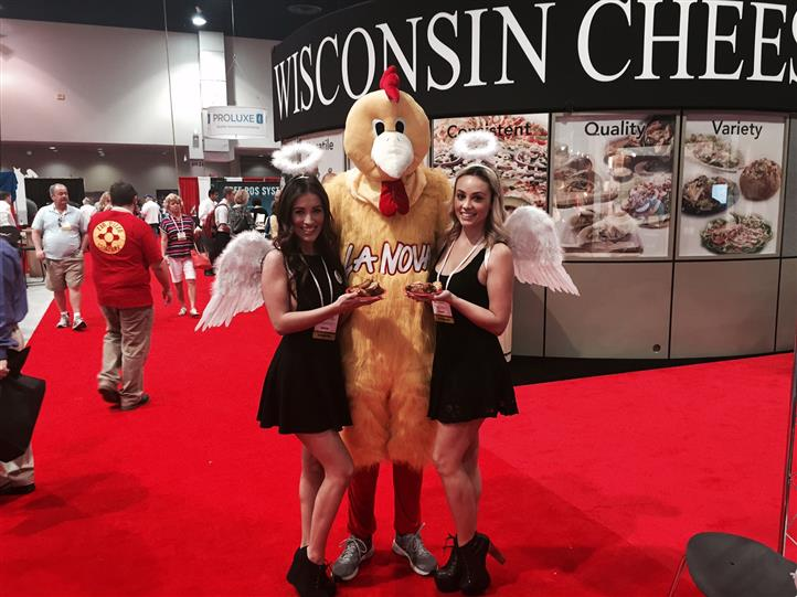 La Nova models holding wings pose with person in chicken costume