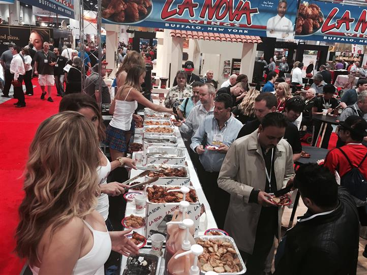 La Nova models handing out wings at food show