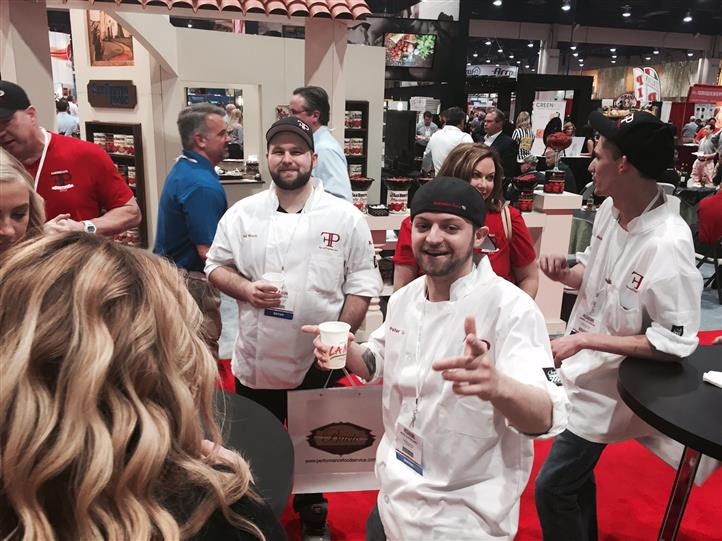 Chefs enjoy beer at La Nova wings station at food show