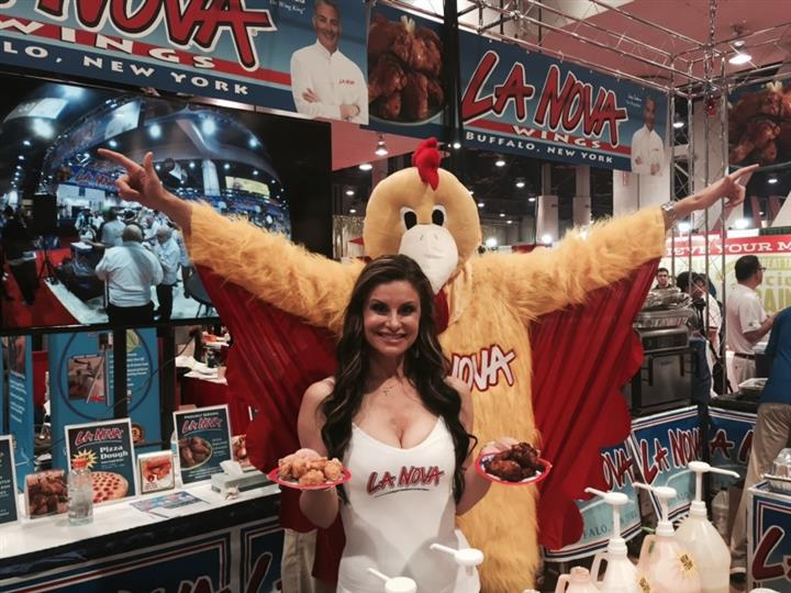 La Nova model holding chicken wings posing with person in chicken suit