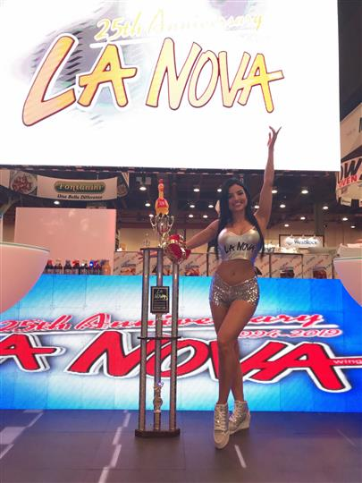 La nova model next to trophy at food show