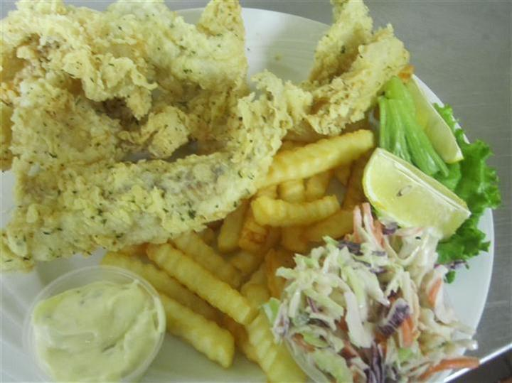 fried fish with french fries, coleslaw and sauce on the side