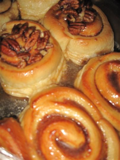 cinnamon rolls topped with pecans