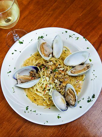 clams over linquine pasta in a clam sauce