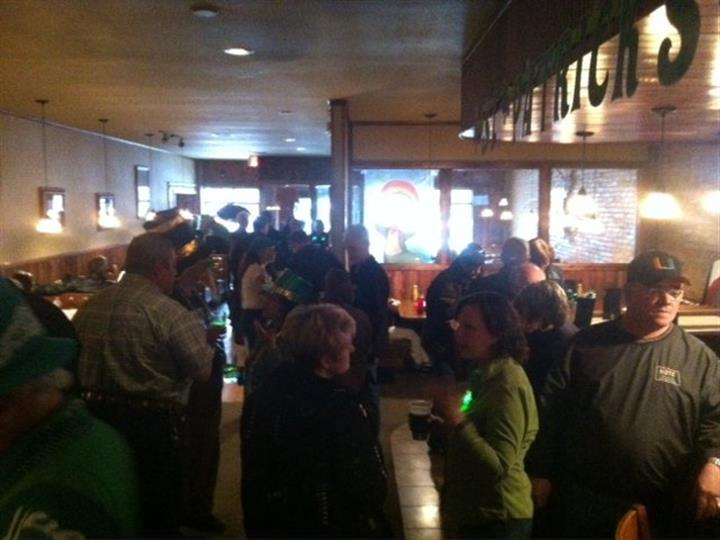 Patrons gathered for Saint Patricks day in dining area