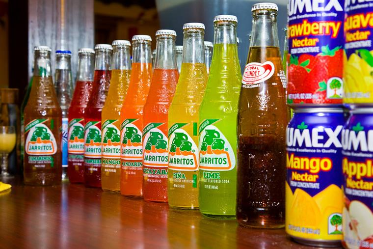 Bottles of colorful mexican soda lined up on counter