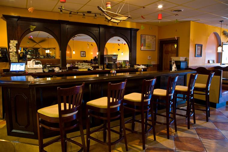 Empty brown bar with brown bar stools
