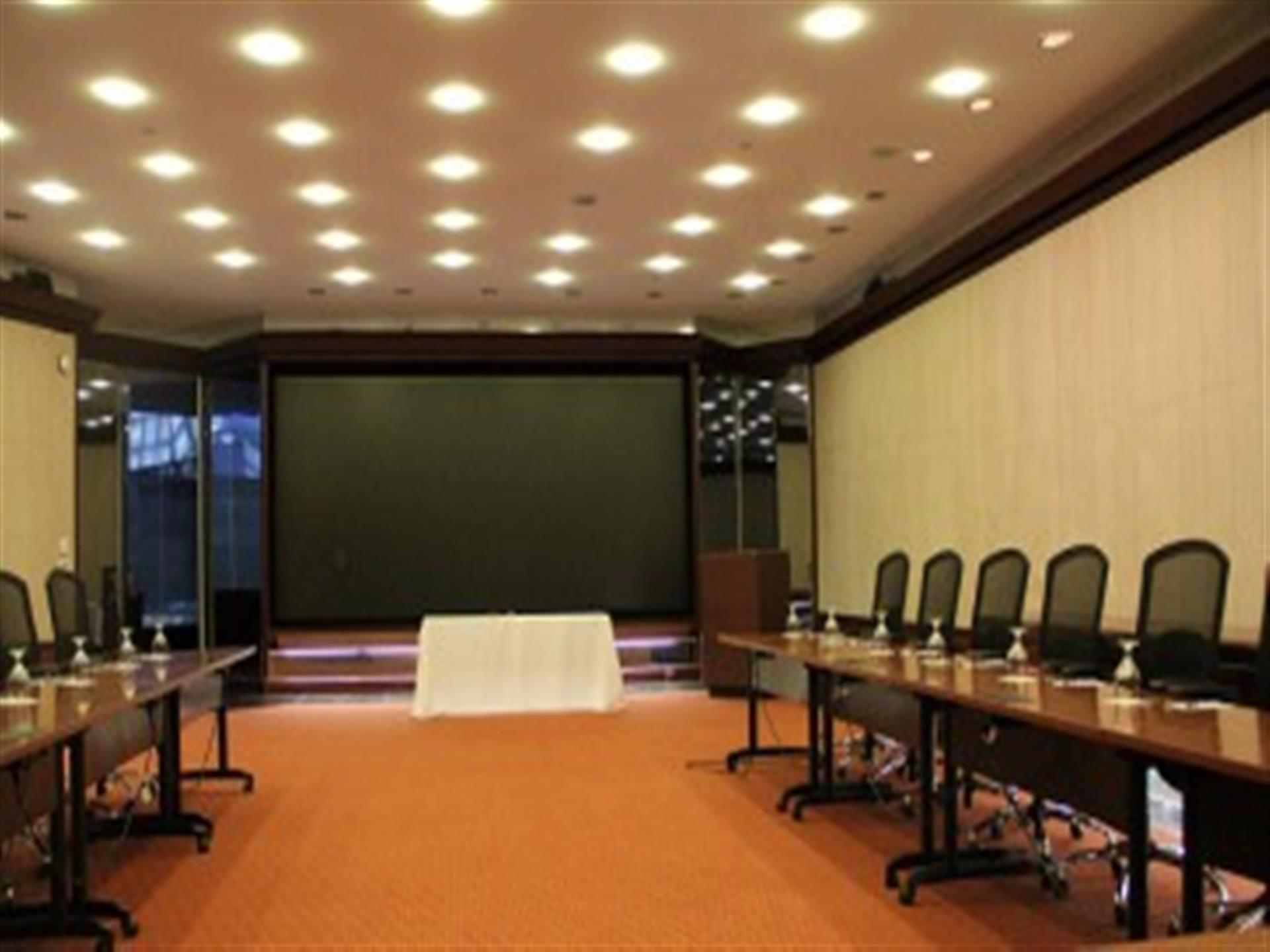 Presentation room with long tables and chairs
