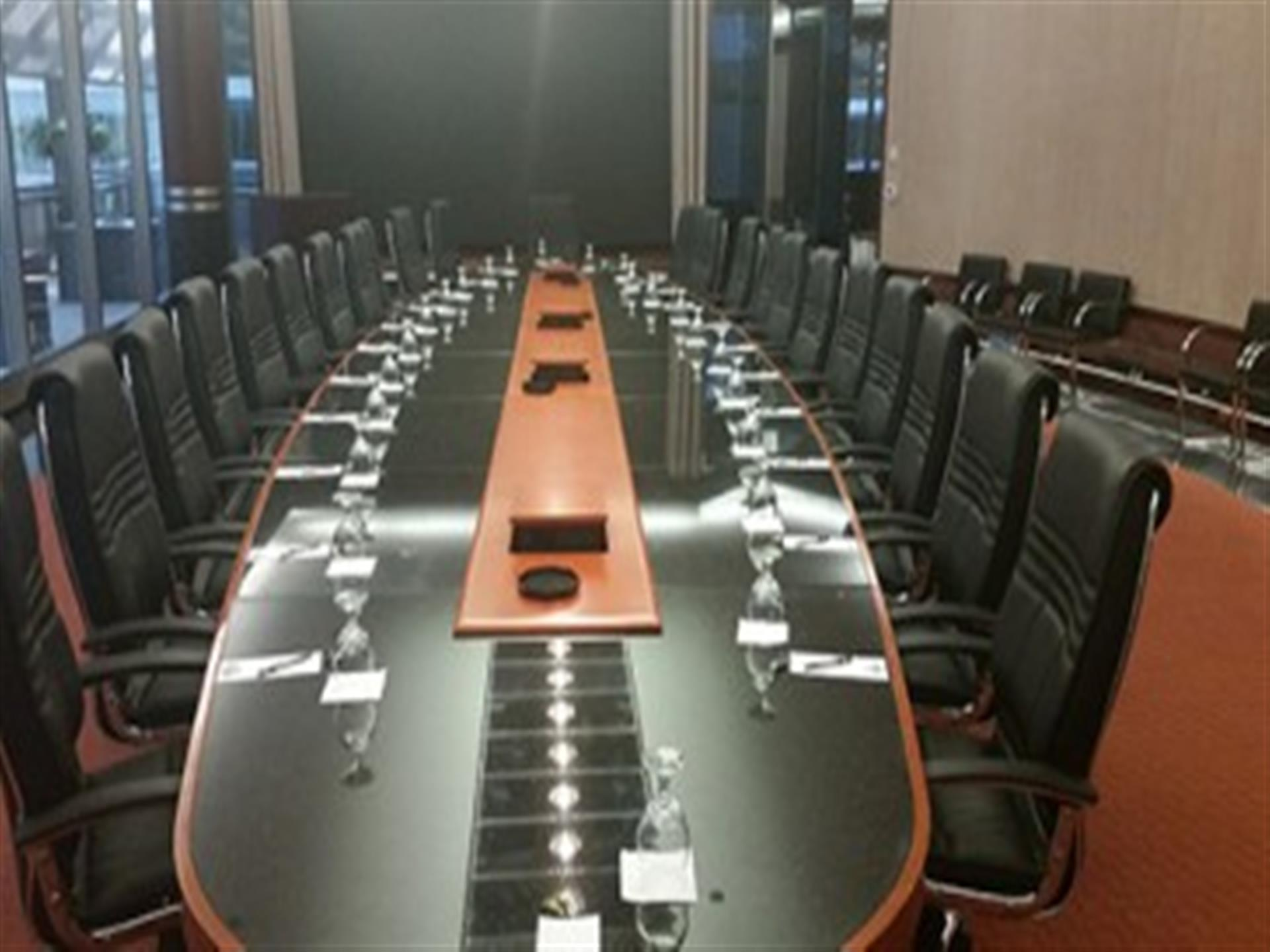 Executive boardroom table with chairs