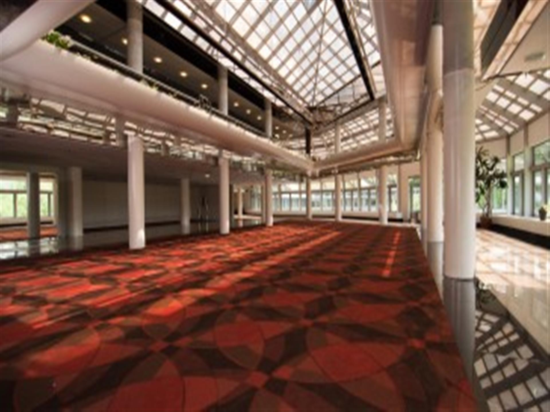 Corridor with red carpet and high celing