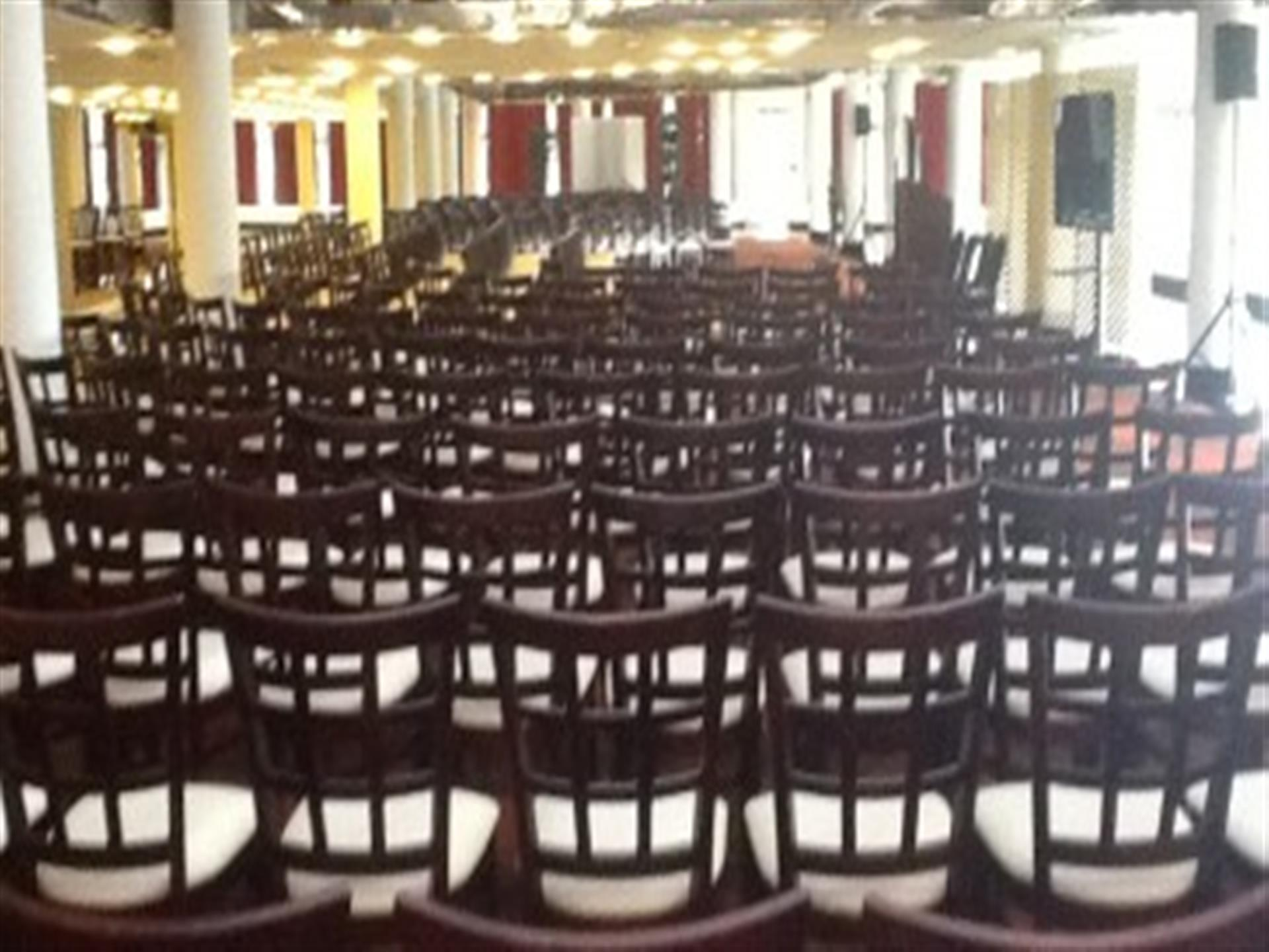 Rows of brown chairs in banquet room