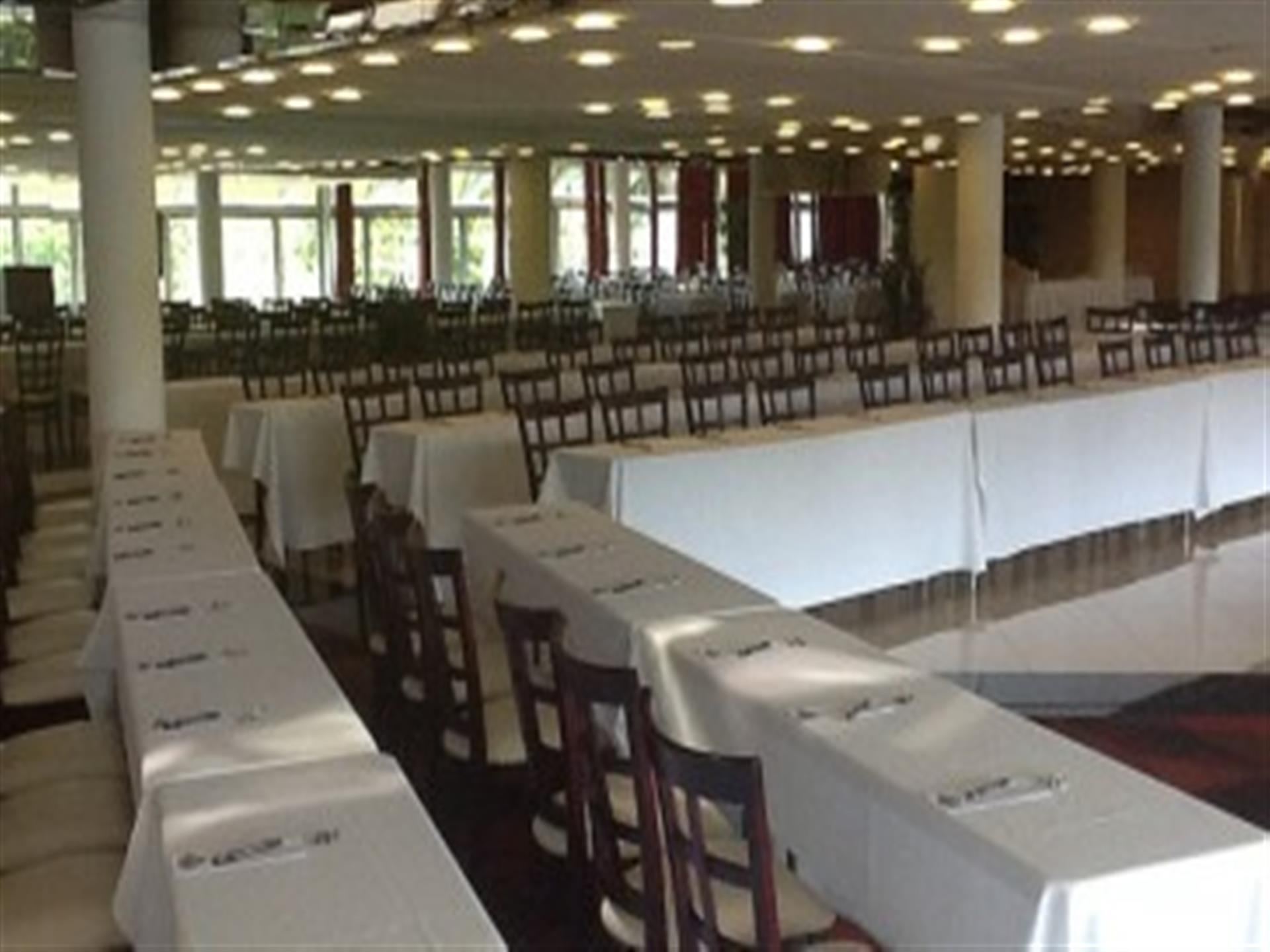 White clothed banquet tables with brown chairs