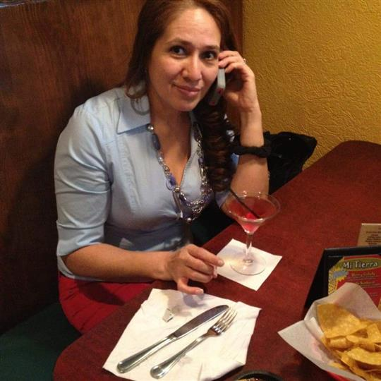 female talking on a phone posing for picture