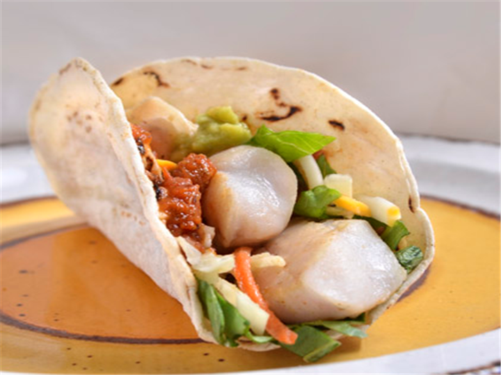 Splendid fish taco. Seasonally available Manitoba Whitefish prepared with ground spices, fresh cilantro and dried chilis.